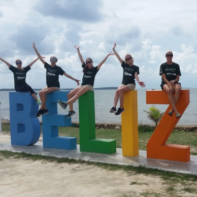 Interns take a break from their public health work in Belize by relaxing with their group.